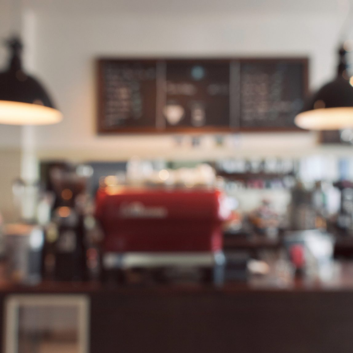 A blurred shot of the counter in a coffee shop.